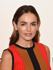 Camilla Belle paired her hairstyle with classic gold hoops.