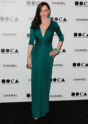 Actress Rose McGowan attended The Artist's Museum Happening MOCA Los Angeles Gala wearing a variety of 18-karat gold turquoise and bronze turquoise Rock Candy bangles.