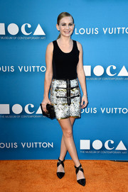 Britt Robertson completed her all-LV ensemble with a black box clutch.