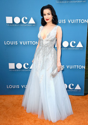 Dita Von Teese completed her dazzling ensemble with a crystal-beaded clutch.