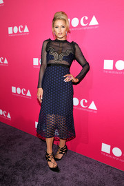Paris Hilton showed some skin in a partially sheer lace midi dress by Self-Portrait at the 2017 MOCA Gala.