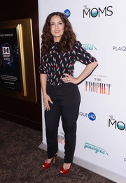 Red patent peep-toes added a bright pop to Salma Hayek's mostly black outfit.