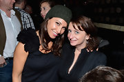 Gina Gershon attended the 24 Hour Plays wearing a dark green knit beanie with her frilly top.