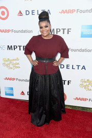 Yvette Nicole Brown attended the Hollywood's Night Under the Stars event wearing a maroon blouse cinched in at the waist with a broad leather belt.