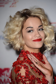 Rita can really pull off bottle-blond curls like these!