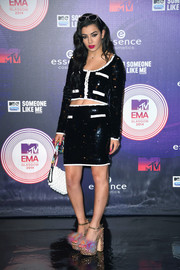 Charli XCX styled her outfit with a colorful pair of feather-and-rhinestone platform sandals.