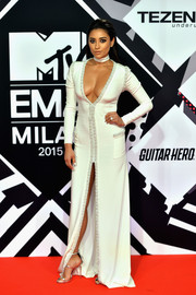 Shay Mitchell looked exotic, sultry, and sophisticated all at once in this plunging, high-slit Kayat gown with beaded trim during the MTV EMAs.