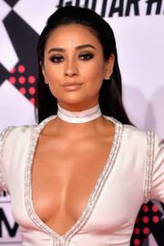 Shay Mitchell accentuated her eyes with a smoky application of sparkly gold shadow.