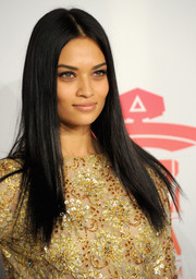 We love this formal long hairstyle -- straightened tresses and a classic center part.