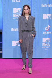 Debby Ryan went masculine-chic in a striped pantsuit by Dzojchen at the 2018 MTV EMAs.