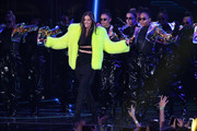 Hailee Steinfeld brought a bright pop of color onstage with this neon-yellow fur coat at the 2018 MTV EMAs.