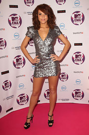 Jade Thompson shined on the red carpet at the EMA's. She paired her look with black platform strappy sandals.