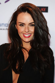 Jennifer Metcalfe punched up her black ensemble with a pop of bright persimmon lipstick at the 2011 MTV Europe Music Awards.