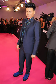 Adam Lambert wore a sleek blue suit with suede loafers and print button-down shirt for the MTV Europe Music Awards.