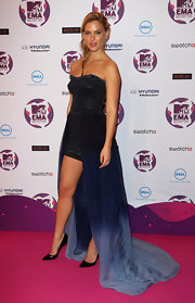 Bar Refaeli has always had a unique sense of style. The gorgeous model made an appearance at the MTV Europe Music Awards in a strapless midnight blue ombre evening dress with a fishtail hem (or perhaps more familiarly known as a mullet dress). Leave it to Bar to show off her long stems even in a floor-sweeping gown. But really, who can blame her?