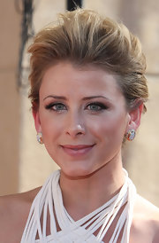 Lo opted for a teased updo with large, stud earrings.