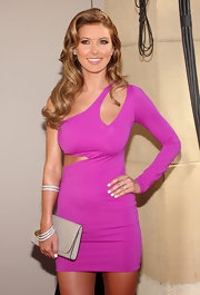 Audrina showed off her daring figure in a cut out pink dress which she topped off with diamond bangle bracelets.