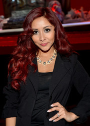 Nicole Polizzi styled her hair with gorgeous lush waves for the MTV Movie Awards press junket.
