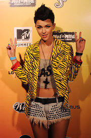 Ruby rocks a bright leopard print zip up jacket to the Wet N Wild MTV Summer Party.