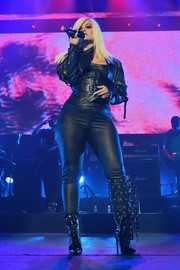 Bebe Rexha sealed off her look with black lace-up boots.