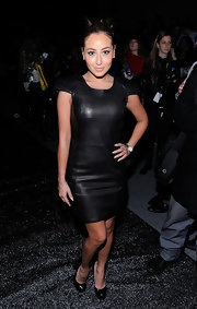 Adrienne was front row at the Mackage fashion show in a fitted leather dress and patent pumps.