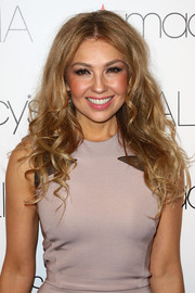 Thalia left her long curls loose when she attended the announcement of her partnership with Macy's.