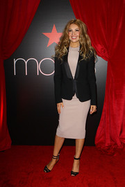 Thalia attended the announcement of her partnership with Macy's looking formal in a satin-lapel blazer layered over a mauve dress.