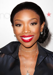 At the Glamorama Fashion Extravaganza presented by Macy's Passport, Brandy wore a lovely pair earrings with large center diamonds surrounded by smaller stones.
