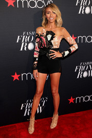 Giuliana Rancic put her tanned body on display in a fitted romper with a beaded illusion bodice during the Fashion's Front Row event.