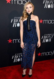 Peyton List showed her more daring side with this skintight blue lace halter dress at the Fashion's Front Row event.