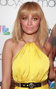 Nicole Richie attended Macy's Fashion Star celebration wearing her layered cut smooth and straight with wispy lash-grazing bangs.