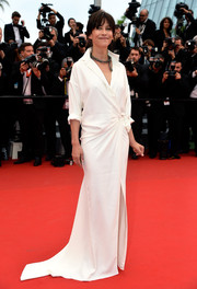 Sophie Marceau looked effortlessly stylish in a white wrap-style shirtdress by Alexandre Vauthier Couture during the 'Mad Max: Fury Road' premiere in Cannes.