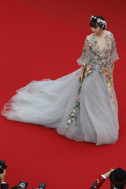 Fan Bingbing floated down the 'Mad Max: Fury Road' Cannes red carpet wearing a goddess-worthy gray Marchesa gown embellished with multicolored flowers.