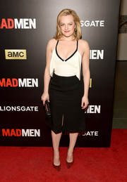 Elisabeth Moss punctuated her monochrome frock with red Stuart Weitzman suede pumps.