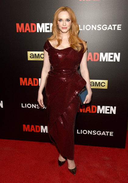 Christina Hendricks paired her dress with an elegant blue Anya Hindmarch Duchess clutch.
