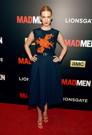 January Jones looked effortlessly stylish at the 'Mad Men' special screening in a Preen dress, highlighted by orange floral embroidery that popped beautifully against the navy background.