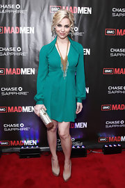 Cara Buono sported a few curls in her do whilst wearing a green long sleeved dress with a plunging neckline. She paired her dress with a long gold statement necklace and nude pumps.
