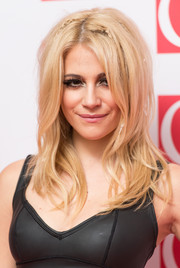 Pixie Lott attended the Q Awards wearing this layered, teased, and partially braided hairstyle.