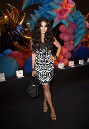 Vanessa Hudgens chose a micro-studded bucket bag by Moschino to finish off her look.