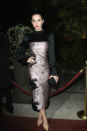 Katy Perry went for vintage glamour in a long-sleeve black and mauve dress during the 'Mademoiselle C' cocktail party.