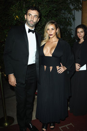 Kim Kardashian looked like a sultry goddess in a cleavage-baring black cutout dress by Givenchy during the 'Mademoiselle C' cocktail party.