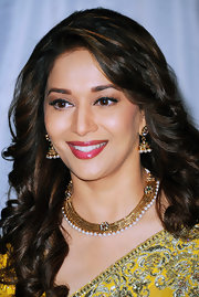 Madhuri Dixit-Nene accessorized with an exquisite gold-and-pearl collar necklace for a totally fab look.