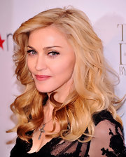 Madonna attended the Macy's Herald Square launch of her new fragrance wearing her long luxuriant mane in soft waves and curls.