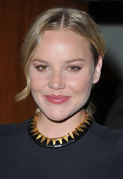 Abbie Cornish, at the 68th Venice Film Festival, wore a berry stain on her lips. A product like Smashbox Limitless Lip Stain & Color Seal Balm in a shade like Berry will recreate Abbie's look while adding a hint of moisture without too much shine.