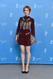 Greta Gerwig went for a Western vibe in a fringed red suede dress by Valentino at the photocall for 'Maggie's Plan.'