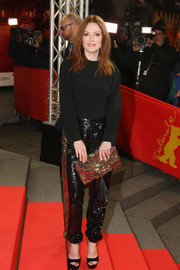 Julianne Moore was in the mood for some sparkle, matching her pants with a gold sequin clutch.