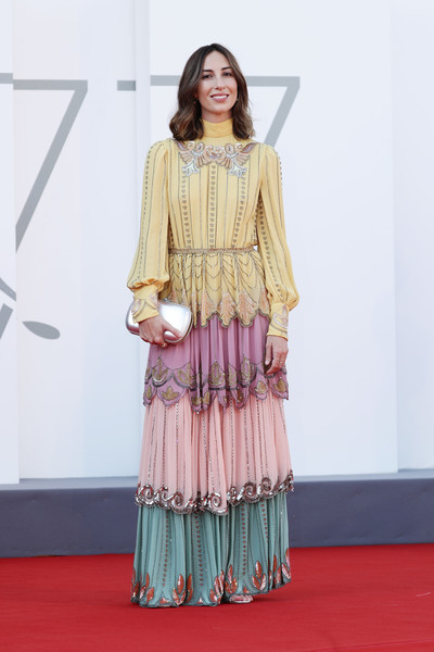 Gia Coppola paired her dress with a metallic silver clutch.