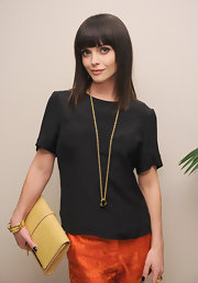 Christina Ricci wore this black silk blouse with her sharp ensemble at the Maiyet Launch celebration.