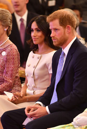 Meghan Markle attended the Queen's Young Leaders Awards ceremony wearing a delicate diamond cross bracelet by Vanessa Tugendhaft.