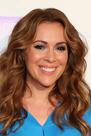 Alyssa Milano showed off her rich ginger locks with beachy waves.